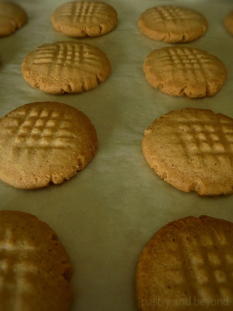 Baked cinnamon cookies on a parchment paper.