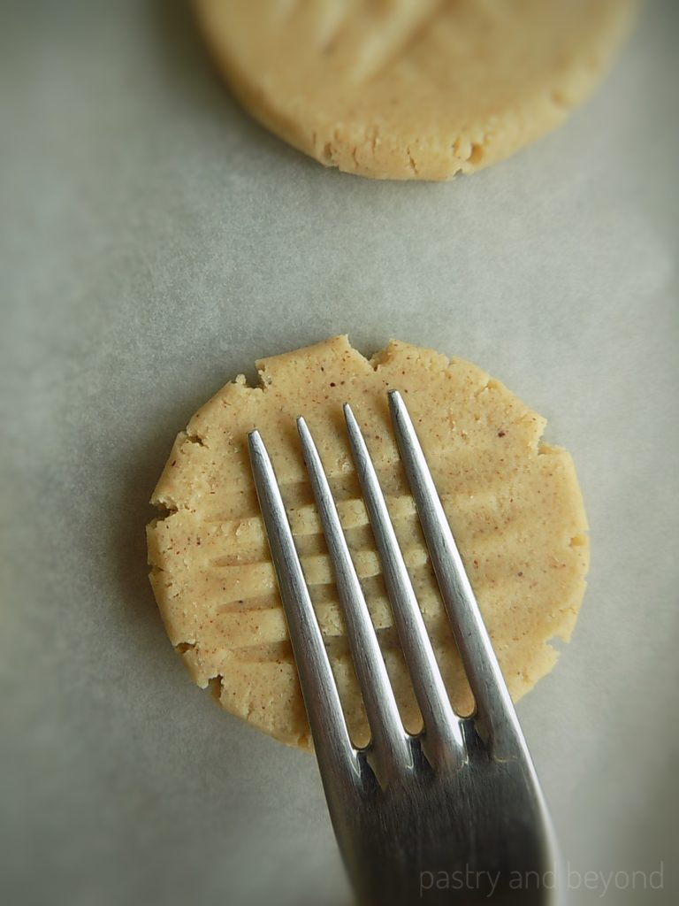 Making criss cross pattern with a back of a fork.