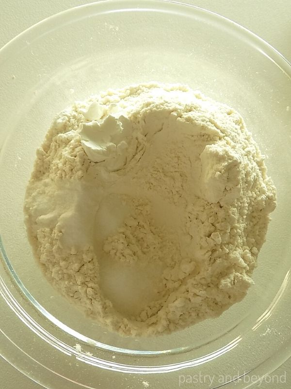 Flour, cornstarch, baking soda and salt in a glass mixing bowl.