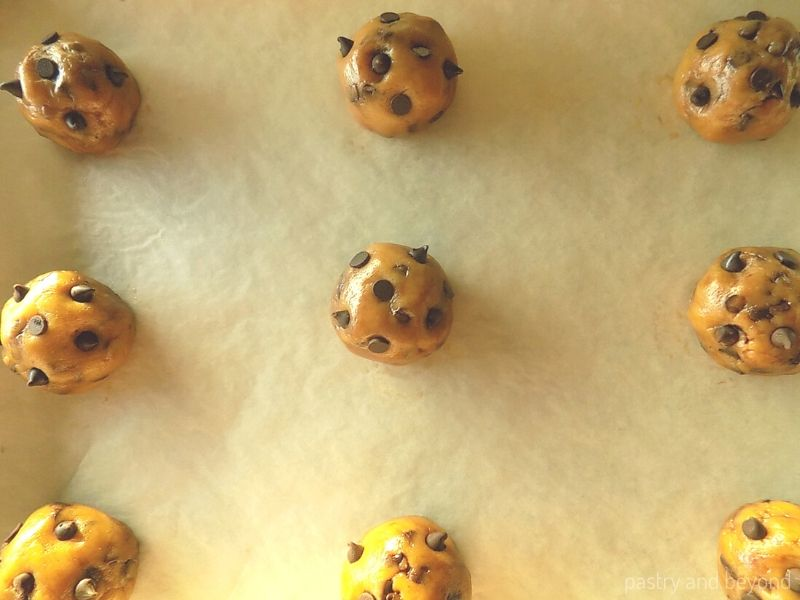 Chocolate Chip Cookie Dough on a parchment paper before baking.
