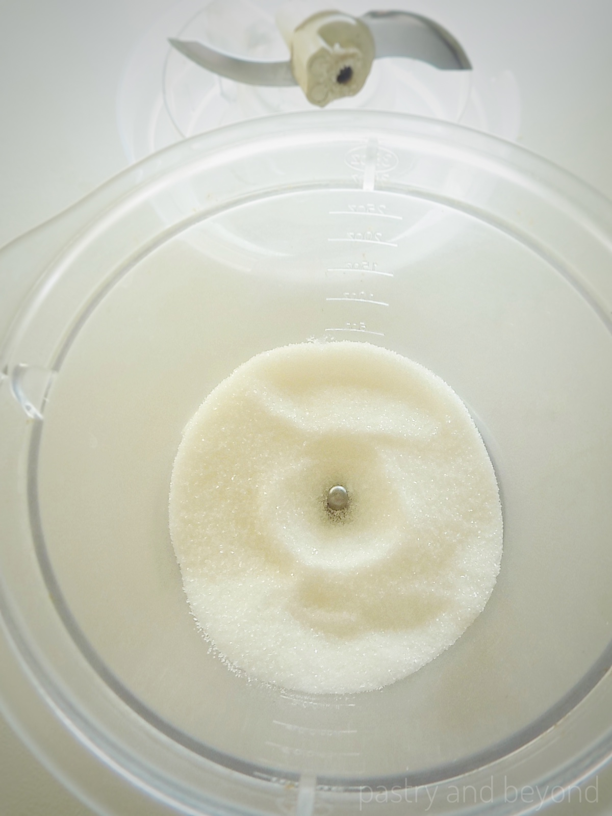Granulated sugar in a food processor.