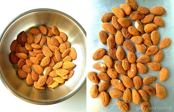 Toasting the almonds in a pan and then spreading them on a baking sheet.