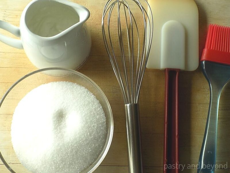 Ingredients and equipment you need to make a homemade caramel sauce.