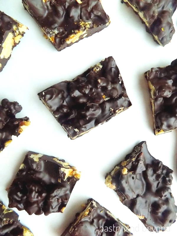 Chocolate candy bark pieces on a white surface.