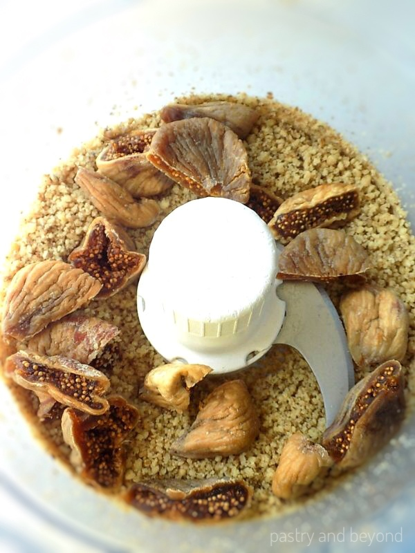 Ground walnuts and chopped dried figs in a food processor.