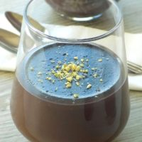 Easy chocolate pudding in a serving glass with pistachios on top.