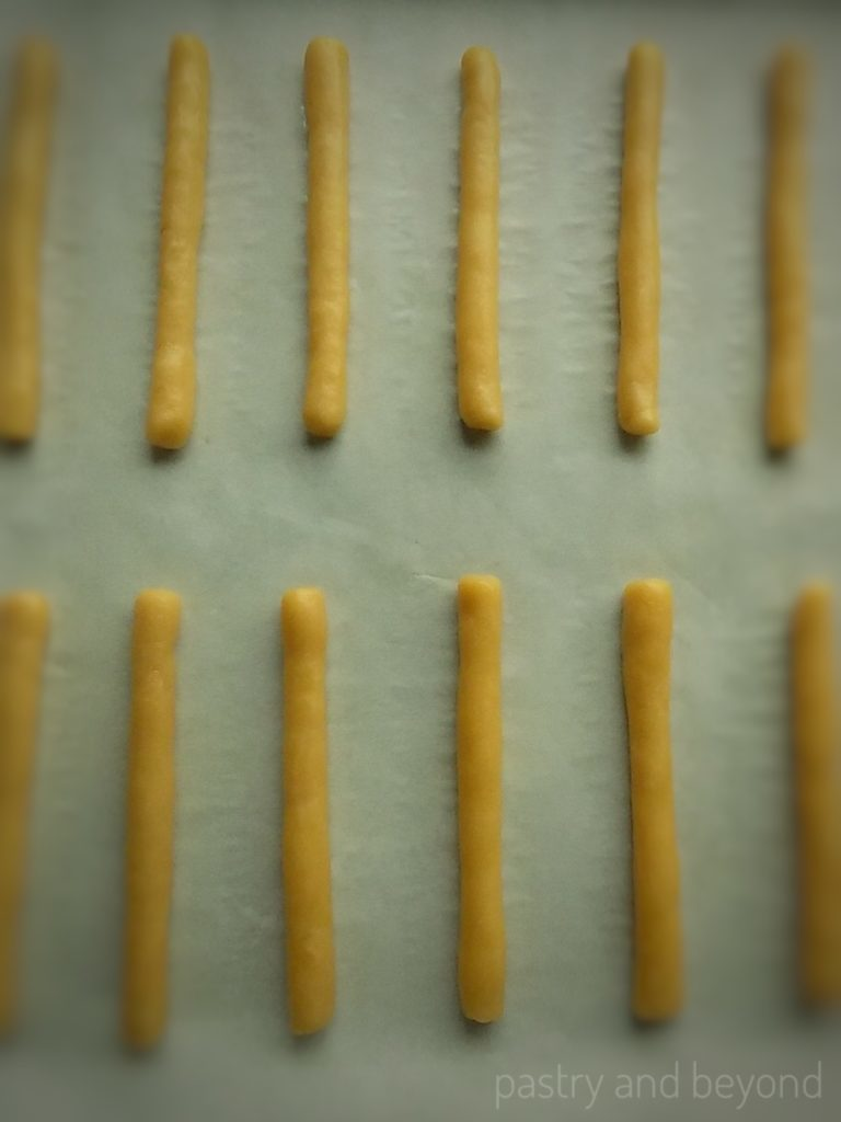 Steps of Chocolate Caramel Sticks: Making sticks out of the dough