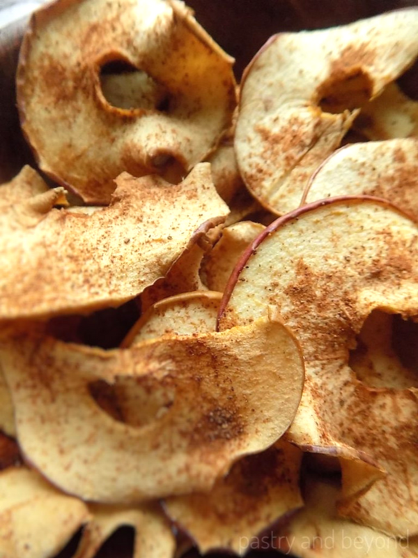 Oven dried apples in a wooden bowl.