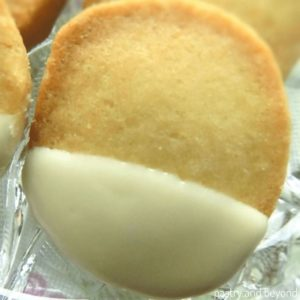 Slice and bake vanilla shortbread cookies on a glass plate.