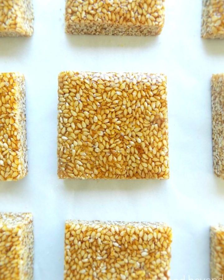 Overhead view of sesame candies on a white surface.