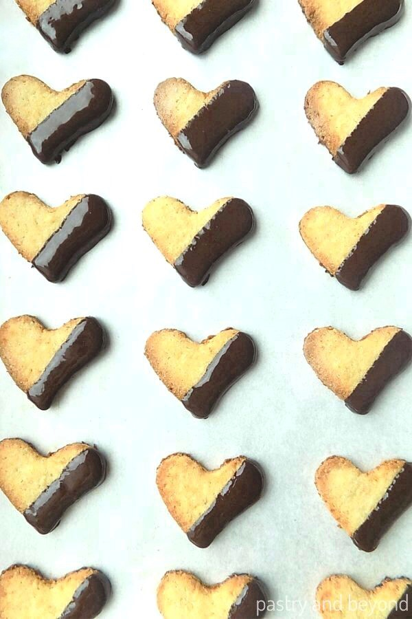 Chocolate Dipped Coconut Cookies on a baking sheet.