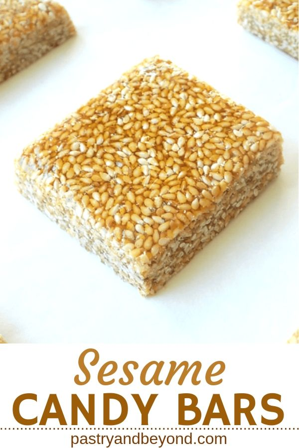 Sesame candy on a white surface. with text overlay.