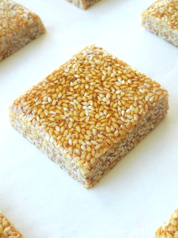 Side view of sesame bar on a white surface.