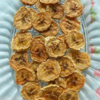 Oven dried bananas in a glass plate.