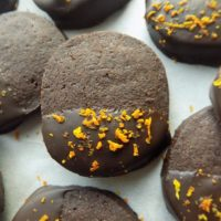 Slice-and-bake chocolate orange shortbread cookies on a white surface.