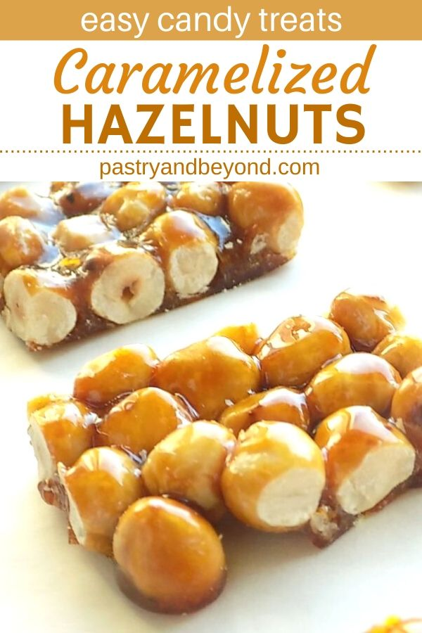 Caramelized hazelnuts on a white surface.