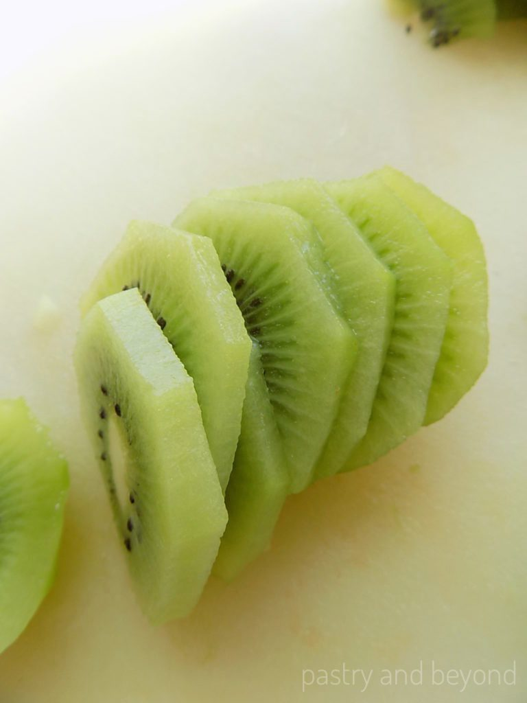 Kiwi slices on a chopping board.