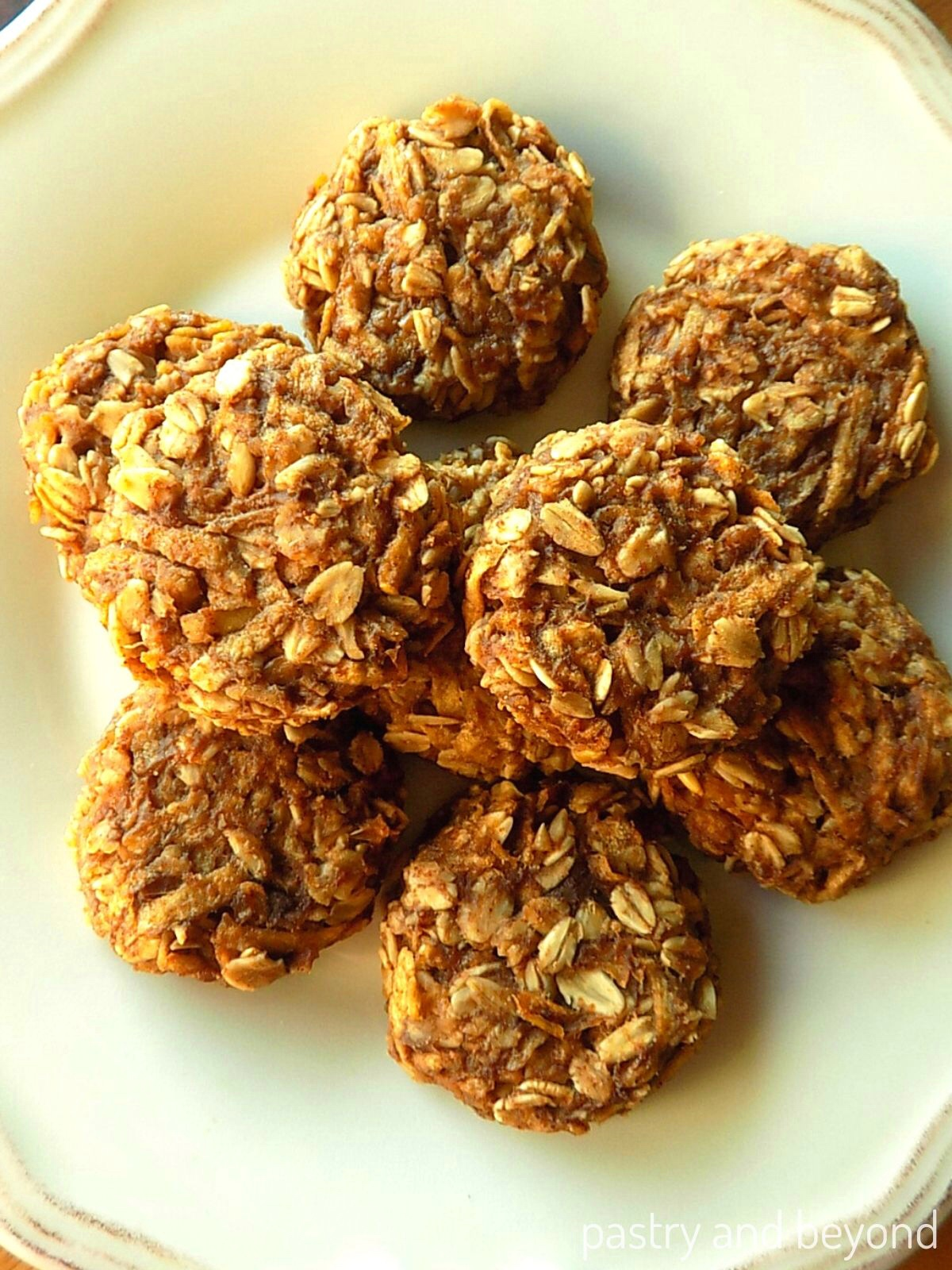 Apple oatmeal cookies on a white plate.
