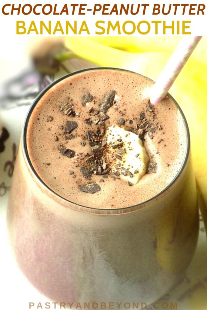 Peanut Butter Chocolate Banana Smoothie in a glass with a pink straw.