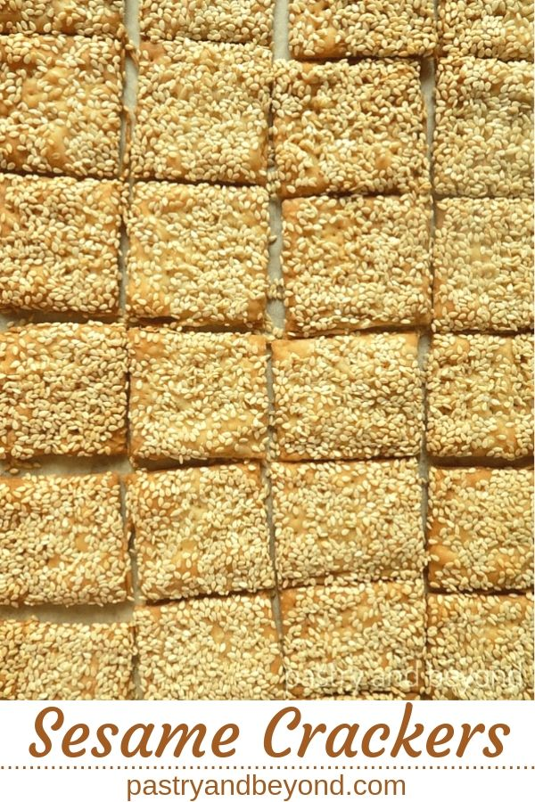 Sesame crackers on a parchment paper with text overlay.