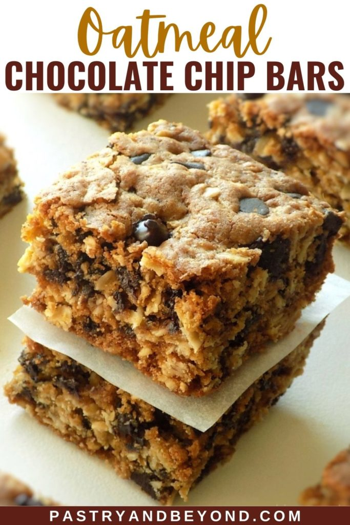 Stacked oatmeal chocolate chip bars on a white surface.