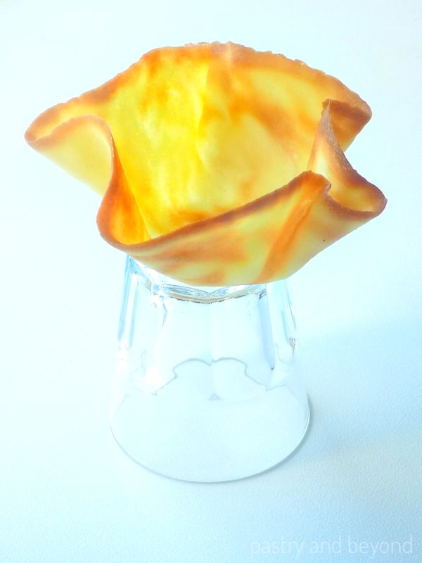 Medium tuile bowl on an inverted glass.