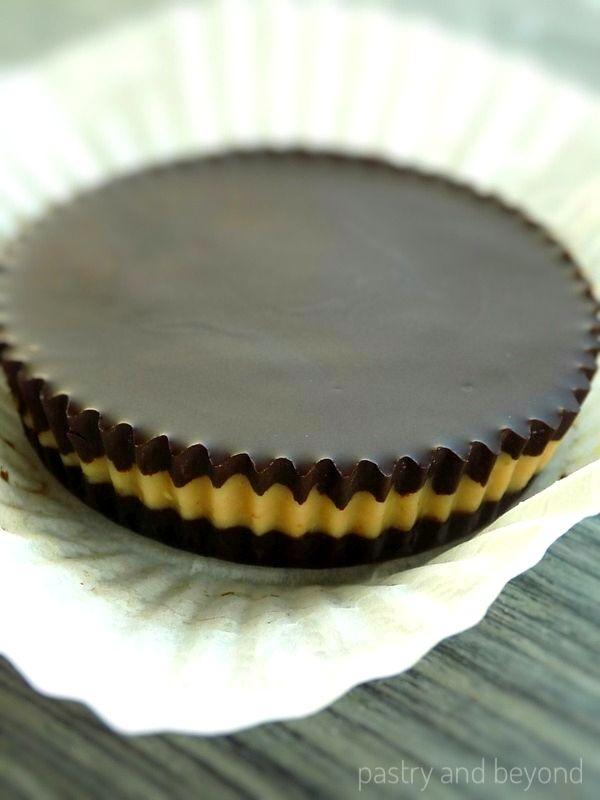 Dark chocolate peanut butter cup in a cupcake liner.