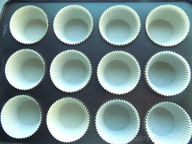 Cupcake liners placed in a muffin tin.