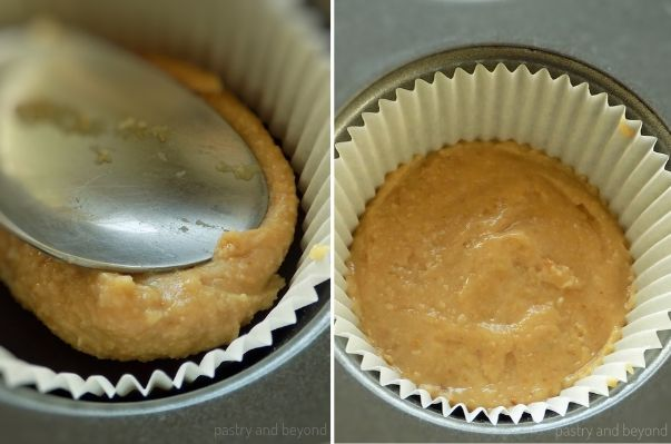 Adding peanut butter over the melted chocolate that is placed in a muffin tin.