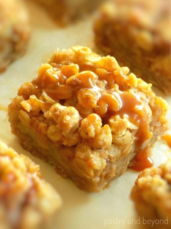 Caramel apple bars with caramel sauce on top.