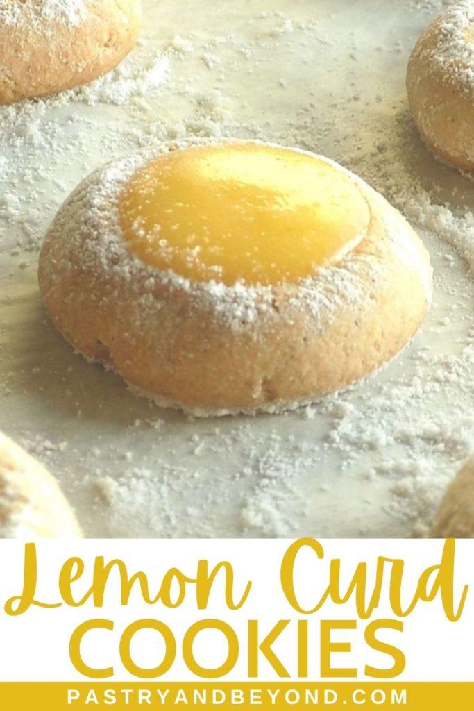 Lemon curd thumbprint cookies on a parchment paper.