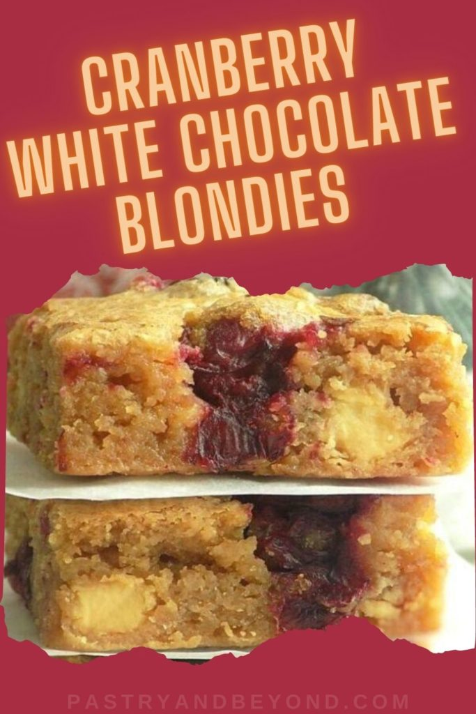 Stacked cranberry white chocolate blondies with text overlay.