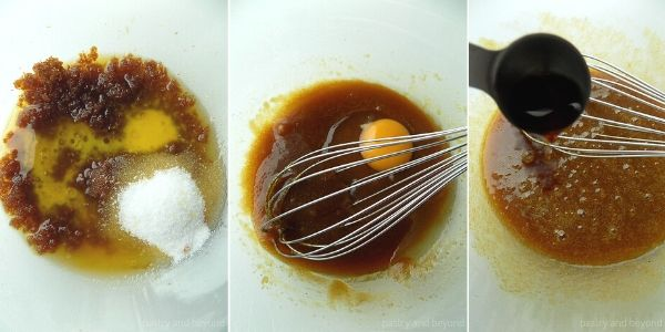 Sugar, melted butter in a glass bowl, egg is added, vanilla is poured from a spoon.