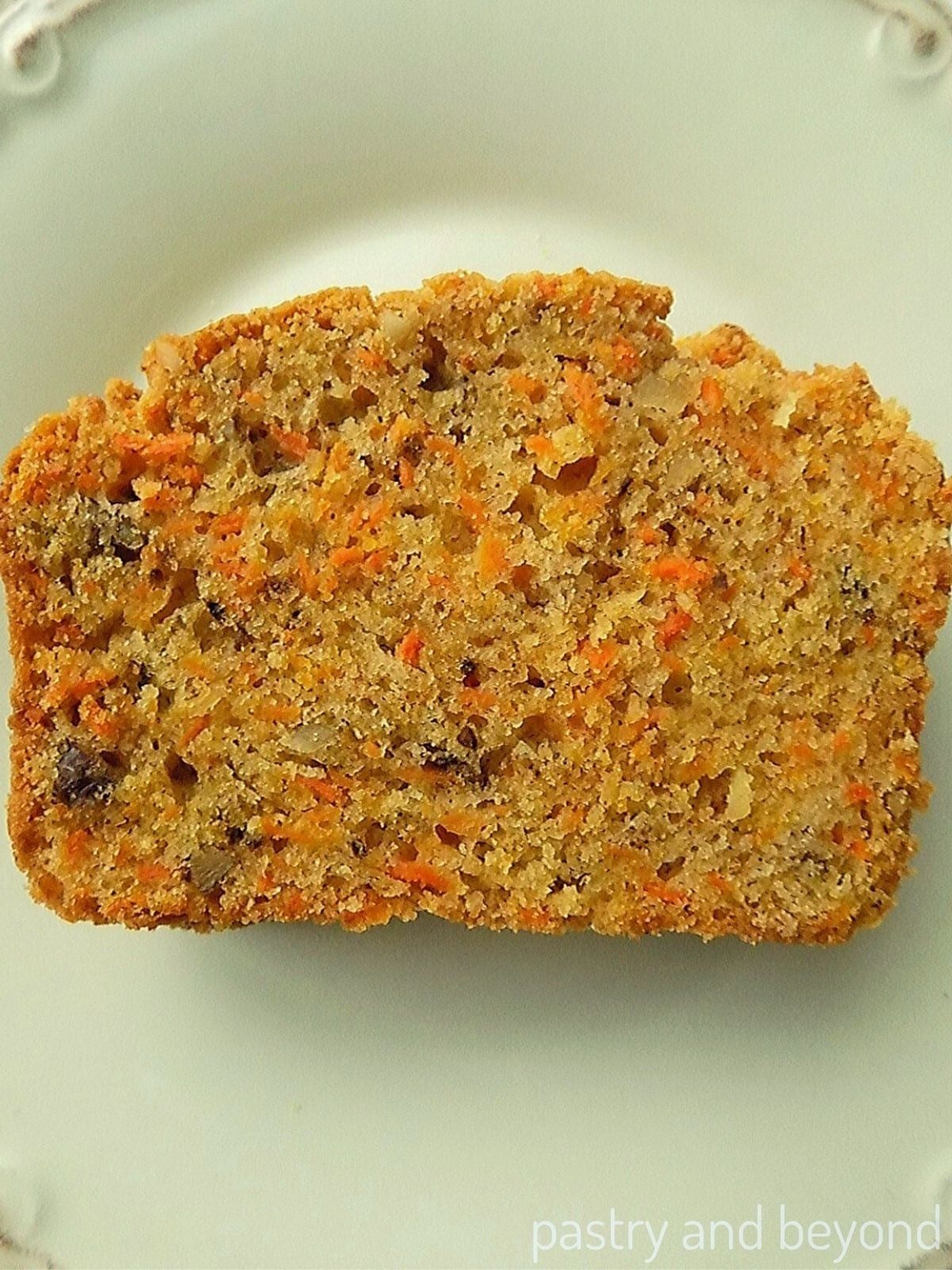 Carrot Cake Loaf slice on a white plate