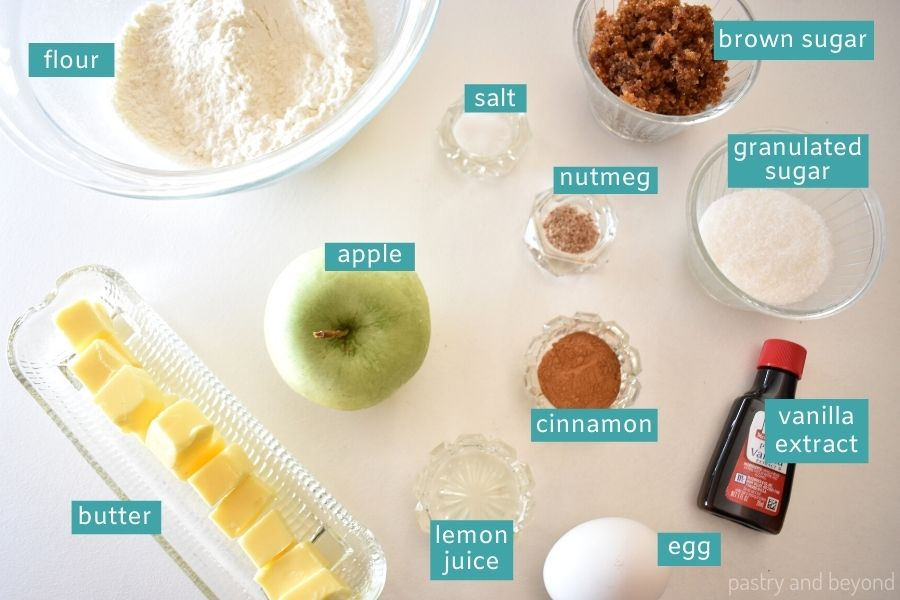 Ingredients for apple blondies on a white worksurface.
