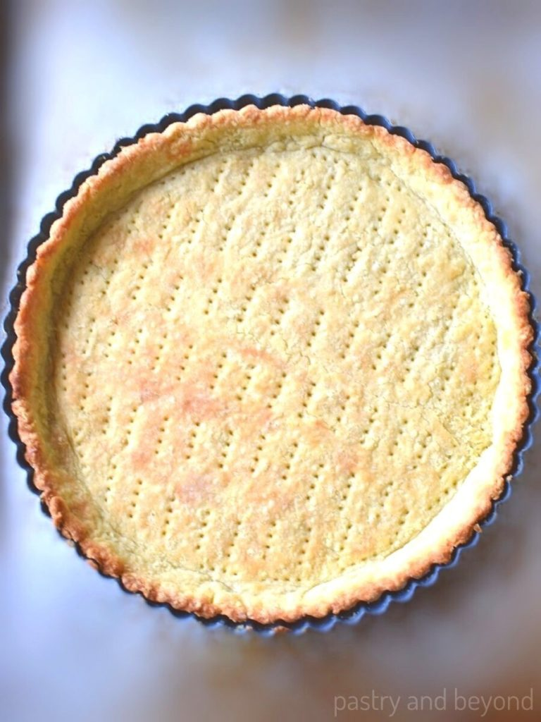 Baked crust in a tart pan.