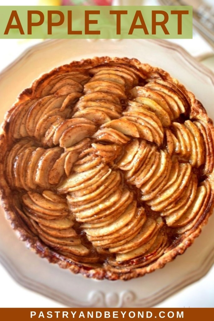 Apple tart in a serving plate with text overlay.