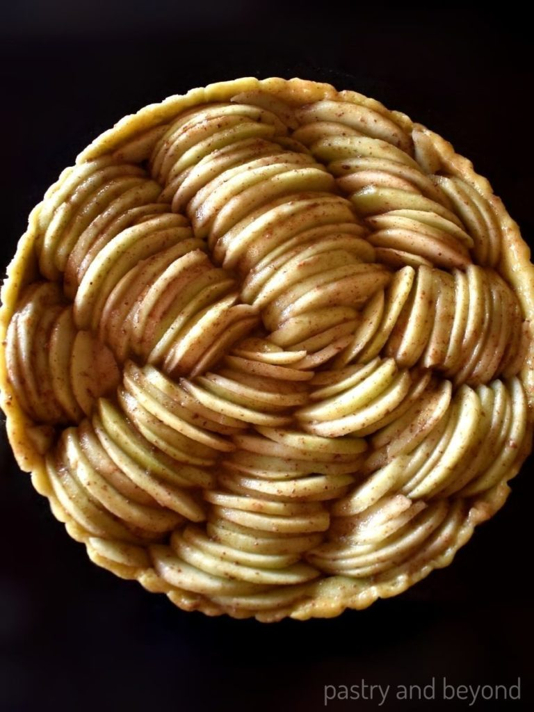 Apples are placed into the unbaked crust.