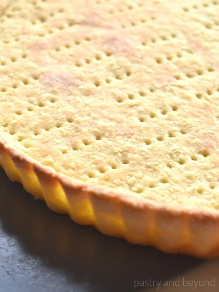 Removing the tart crust from the pan.