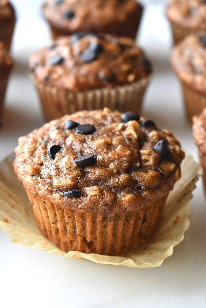 Banana oatmeal muffins with chocolate chips on a white surface