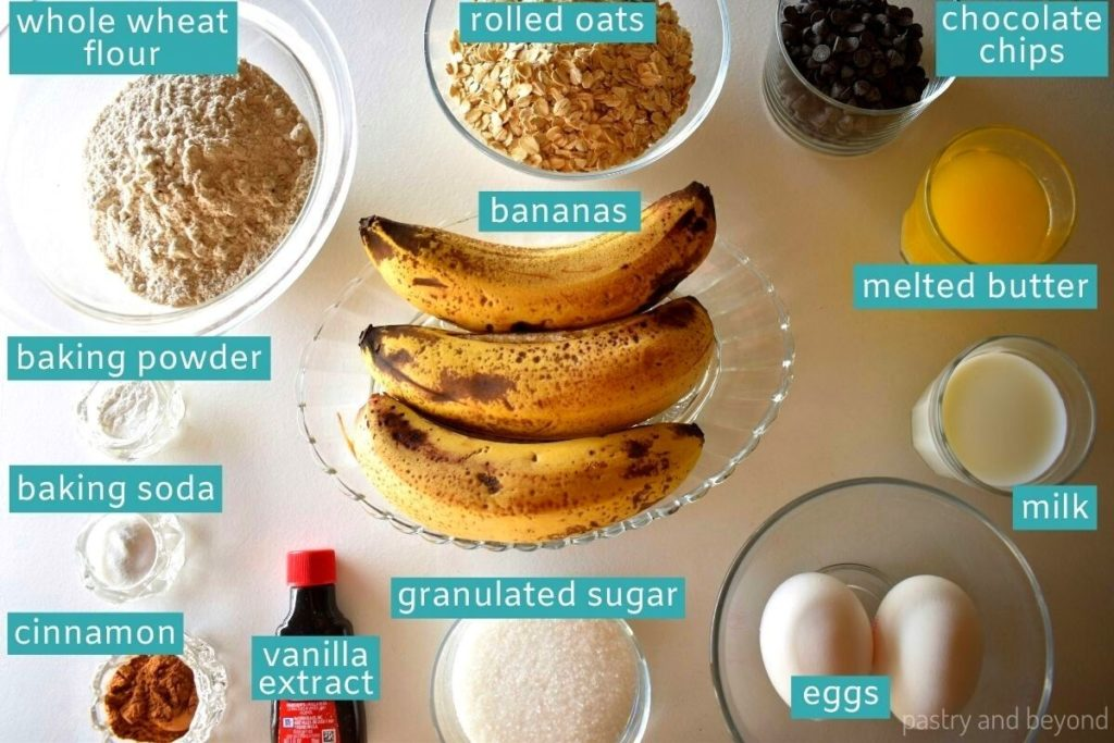Ingredients for banana chocolate chip oatmeal muffins on a white surface.