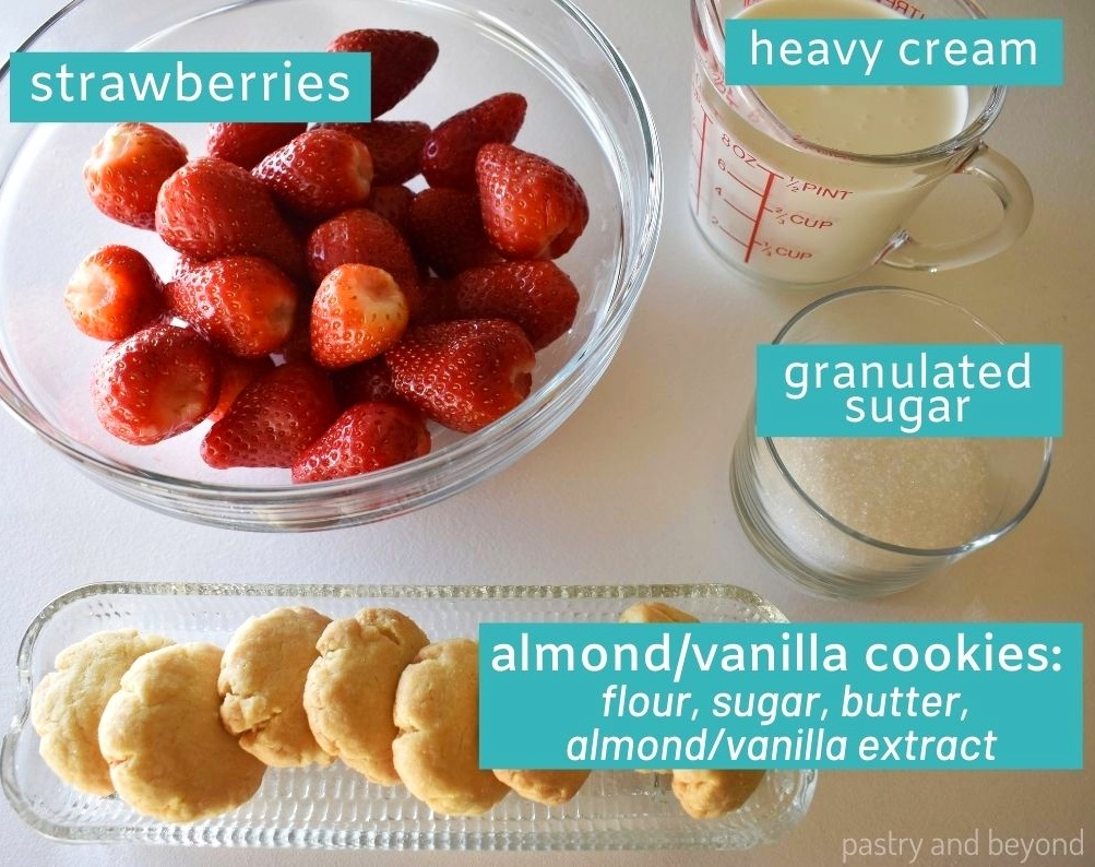 Ingredients for strawberry mousse dessert on a white surface.
