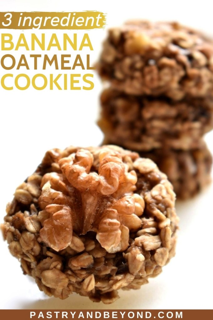 Banana walnut oatmeal cookie with stacked cookies in the background.